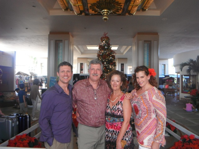 We spent last Christmas with PJ and Suzanne in Hawaii. Here we are on Christmas morning after a lovely holiday lunch buffet (and before I sliced my hand open during the last snorkel trip before catching our plane home... with a visit to the hospital for stitches!)