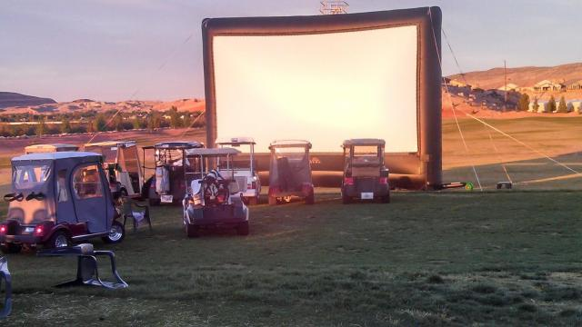 Additional proof of the awesomeness that is St George. As we were leaving dinner at the golf course the locals were readying for the evening's entertainment: golf car drive-in movies! Yes! AWESOME!!!!